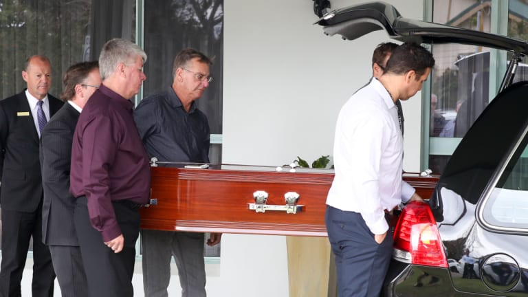 Pallbearers taking away the coffin of Kristie Powell. Relatives said she was kind, loyal, opinionated and generous.