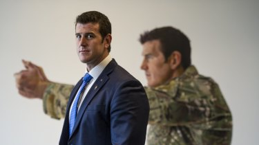 Ben Roberts-Smith in front of his portrait at the Australian War Memorial in Canberra.