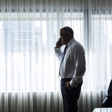 Scott Morrison on the phone to wife Jenny during a break in his Brisbane hotel room.
