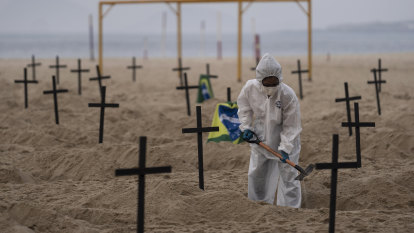 Graves dug in Copacabana Beach to protest handling of COVID-19 pandemic