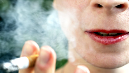 Squinting smokers: Price boards shrunk under tough new tobacco laws