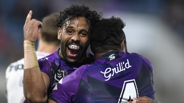 SUNSHINE COAST, AUSTRALIA - AUGUST 30: Joshua Addo-Carr of the Storm celebrates the try of Justin Olam of the Storm during the round 16 NRL match between the Melbourne Storm and the Manly Sea Eagles at Sunshine Coast Stadium on August 30, 2020 in Sunshine Coast, Australia. (Photo by Ian Hitchcock/Getty Images)