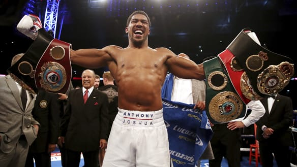 Joshua retains heavyweight crowns with Povetkin TKO