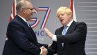British Prime Minister Boris Johnson, right, meets Australian Prime Minister Scott Morrison for bilateral talks during the G-7 summit.
