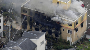 Smoke billows from a three-storey building of Kyoto Animation in a fire in Kyoto, western Japan on Thursday.