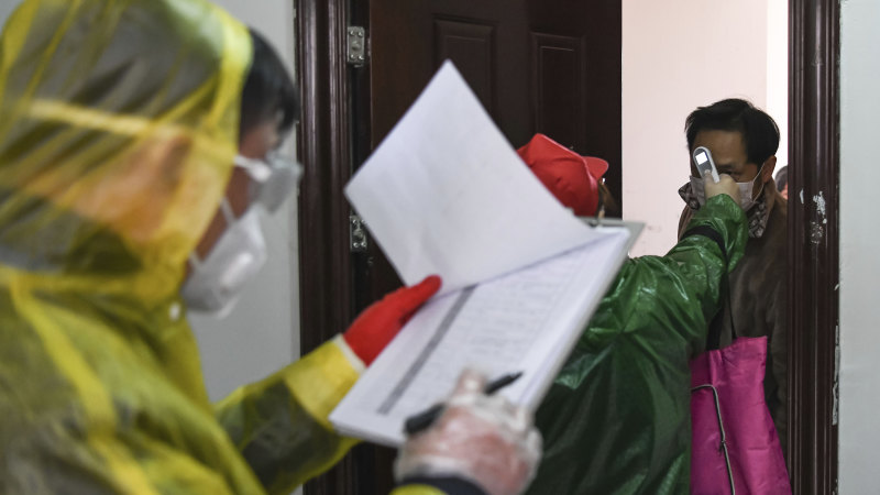 Authorities search door-to-door for coronavirus in Wuhan as cases fall