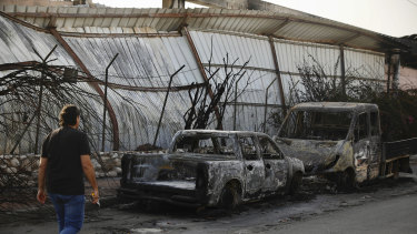 Burnt cars sit in Sderot, southern Israel, after Tuesday's rocket firing from Gaza.