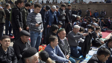 Men pray at a mosque in Almaty, Kazakhstan.
