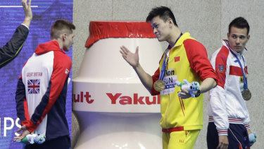 Gold medalist China's Sun Yang confronts  Britain's Duncan Scott after a medal ceremony at the world championships.