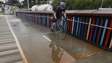 Brown sediment lies on a bike path.