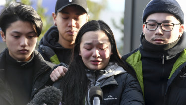 Trish Nguyen, Thomas Tran's girlfriend, was supported by friends at the scene on Tuesday morning.