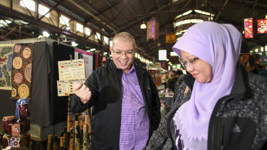 Malaysian Foreign Minister Saifuddin Abdullah and his wife Norlin Shamsul Bahri visit Queen Victoria Market on Sunday.