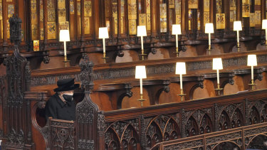 Queen Elizabeth II sits alone in St George's Chapel ahead of the funeral of Prince Philip.