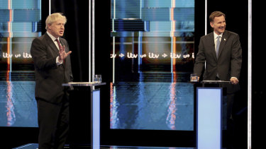 Britain's Conservative Party leadership candidates Boris Johnson, left, and Jeremy Hunt, during a live head-to-head TV debate.
