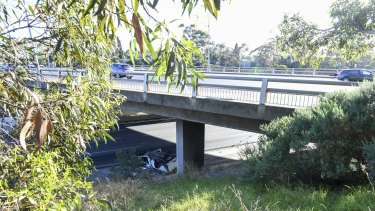 The overpass on the Monash Freeway where a man's white sedan rolled on Monday night.