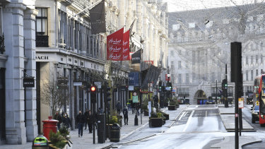 London's Regent Street in uncharacteristically quiet after shops were forced to close under Tier 4 restrictions.