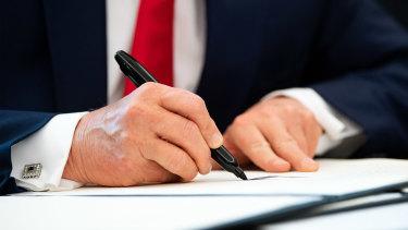 US President Donald Trump signs an executive order imposing sanctions on Iran's supreme leader,Ayatollah Ali Khamenei, last month.
