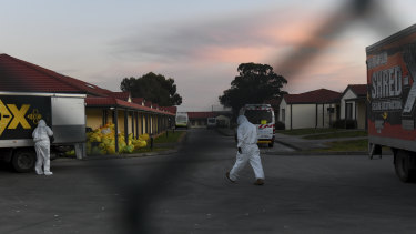 Workers in protective gear at a Melbourne aged care home.