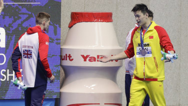 """I win, you lose"": Gold medalist China's Sun Yang, right, gestures to Britain's bronze medalist Duncan Scott."
