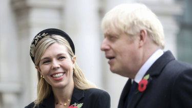 Britain's Prime Minister Boris Johnson, right, with partner Carrie Symonds.