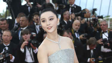 Fan Bingbing poses for photographers upon arrival at the opening ceremony of the 71st international film festival, Cannes.