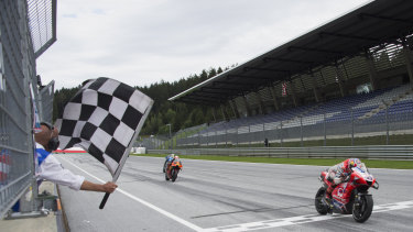 Jack Miller crosses the finish line at the Styrian Grand Prix in Austria.