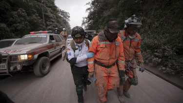 Firefighters and rescue workers leave the Volcano de Fuego evacuation area.