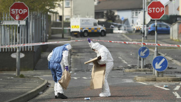Police forensic officers at the scene in Londonderry, Northern Ireland.