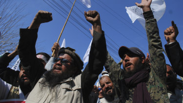 Protesters rally to express solidarity with Indian Kashmiris struggling for their independence in Peshawar, Pakistan.