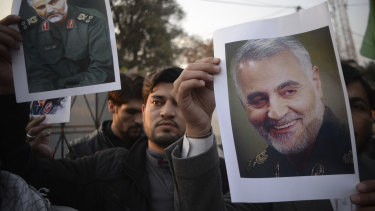 Pakistanis demonstrate over the US air strike in Iraq that killed Iranian Qassem Soleimani, in Peshawar, Pakistan, on Friday.