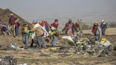 Rescuers work at the scene of the crash near Bishoftu, or Debre Zeit, south of Addis Ababa,  Ethiopia, on Monday.