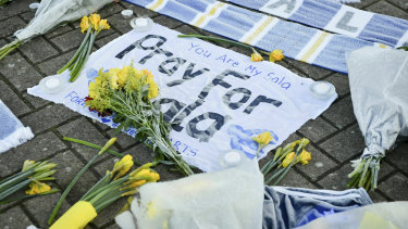 Flowers and tributes are placed outside Cardiff City Football Club in Wales.
