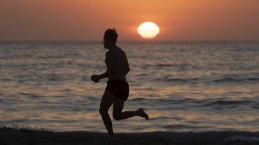 The sun rises at Bondi Beach ahead of a hot day on Saturday.
