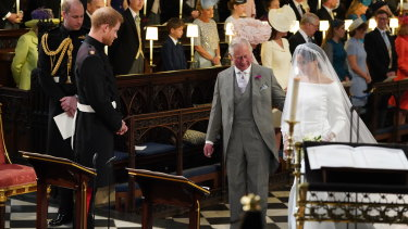 Meghan Markle accompanied by Prince Charles.
