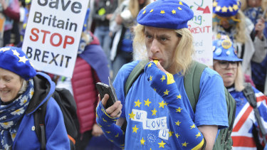 Demonstrators protest against Brexit as the governing Conservative Party start their annual four-day party conference on Sunday.