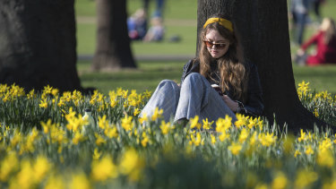 A woman enjoys the London sun on Saturday.