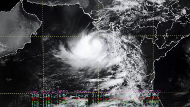 A computer screen shows a satellite image of Cyclone Vayu at a cyclone monitoring centre at the Indian Meteorological Department office in Delhi, India.