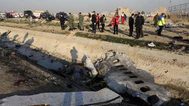 The wreckage of the airliner was strewn across farmland near the airport.