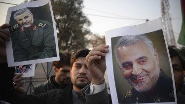 Pakistanis demonstrate over the US air strike in Iraq that killed Iranian Qassem Soleimani, in Peshawar, Pakistan.