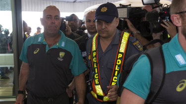 Australia coach Darren Lehmann is mobbed by cameras as the team travel from Cape Town to Johannesburg.