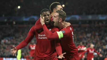 Georginio Wijnaldum is jumped by teammates after scoring Liverpool's third.