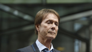 Singer Cliff Richard leaves the Rolls Building where he was awarded more than 200,000 sterling pounds in damages after winning his High Court privacy battle against the BBC.