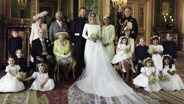 Britain's Prince Harry and Meghan Markle, centre, in Windsor Castle with (from left, back row) Jasper Dyer, Camilla, Duchess of Cornwall, Prince Charles, Doria Ragland, Prince William; (centre row) Brian Mulroney, Prince Philip, Queen Elizabeth II, Kate, Duchess of Cambridge, Princess Charlotte, Prince George, Rylan Litt, John Mulroney; (front row) Ivy Mulroney, Florence van Cutsem, Zalie Warren, Remi Litt.