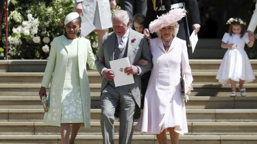 Doria Ragland, Prince Charles and Camilla, Duchess of Cornwall, walk down the steps of St George's Chapel.