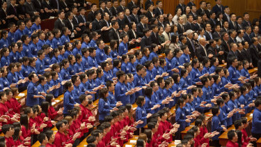 Chinese students applaud during a commemoration of the 100th anniversary of the May 4 Movement at the Great Hall of the People in Beijing on Tuesday.