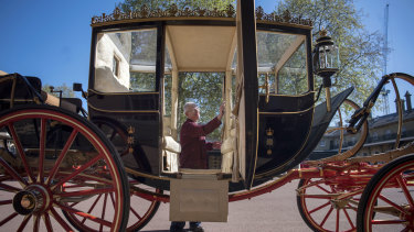 Martin Oates polishes the Scottish State Coach at the Royal Mews at Buckingham Palace. The carriage will be used if it's raining. If it's sunny, an open-top carriage will be used to transport the happy couple.