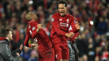 Fabinho and Virgil van Dijk celebrate Liverpool's comeback win.
