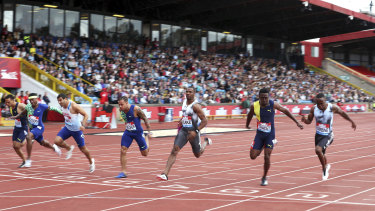 Jamaica's Yohan Blake (third right) claimed the win in the men's 100 metres.
