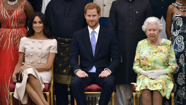 The Duke and Duchess of Sussex with the Queen at the Queen's Young Leaders Awards Ceremony at Buckingham Palace in London.