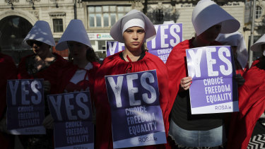 Volunteers from Reproductive rights, against Oppression, Sexism & Austerity (ROSA) dressed as characters from 'The Handmaid's Tale', demonstrate in Dublin calling for a 'Yes' vote.